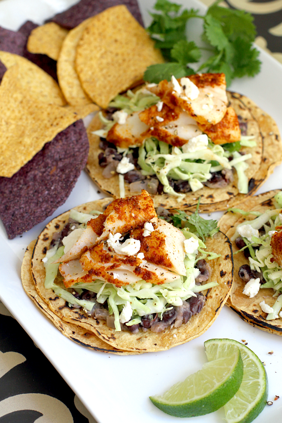 Easy fish tacos with cilantro lime slaw two of a kind for Fish tacos with coleslaw