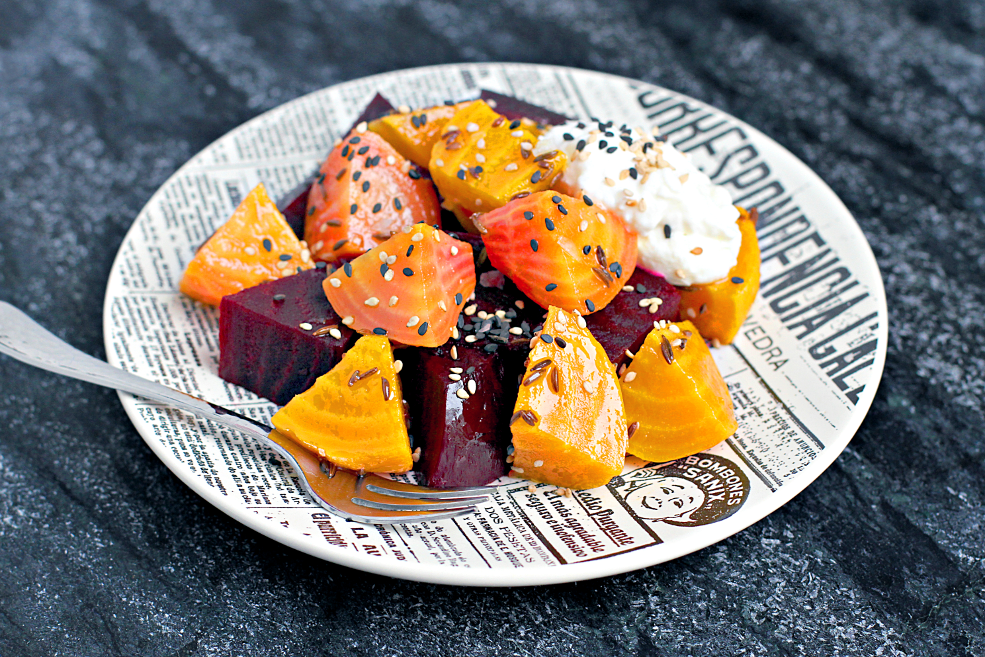 Close-up image of roasted and marinated beets with fromage blanc.