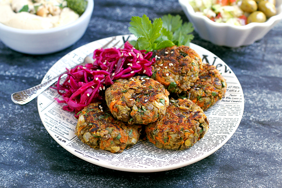 Close-up image of lentil patties with pickled cabbage.