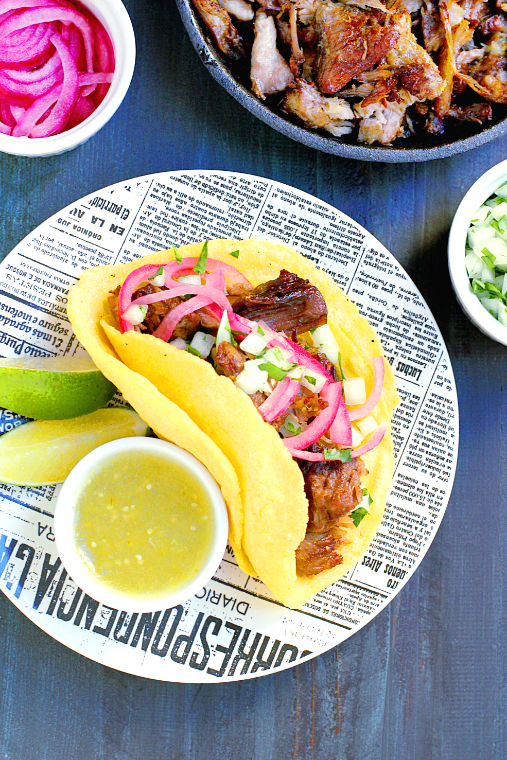 Image of slow-roasted carnitas with salsa verde taco.