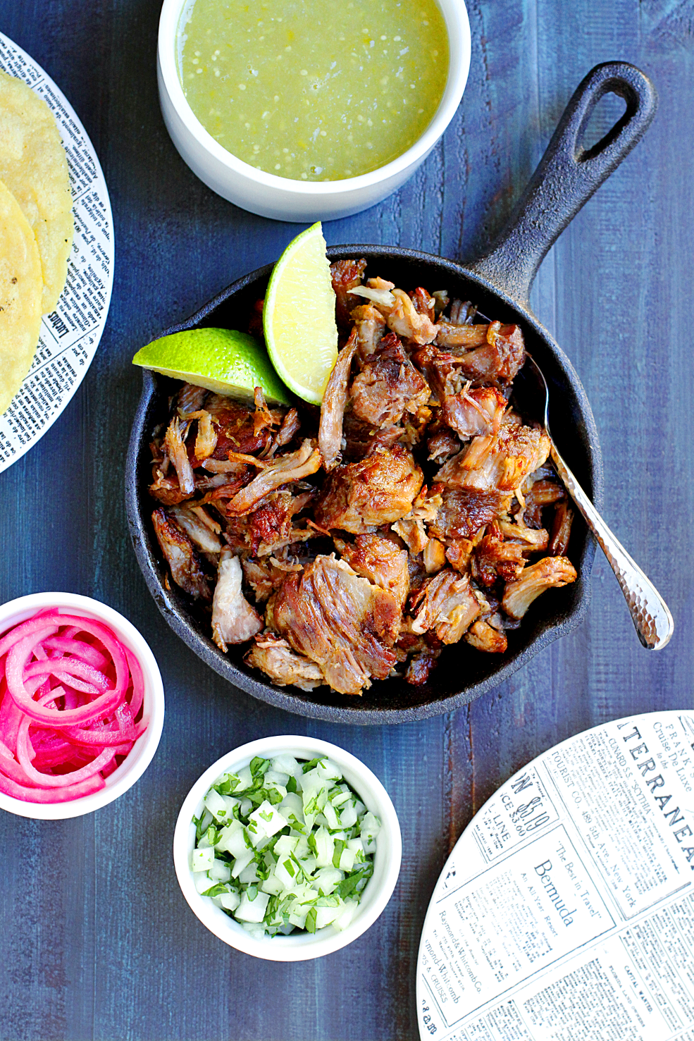 Image of slow-roasted carnitas with salsa verde.