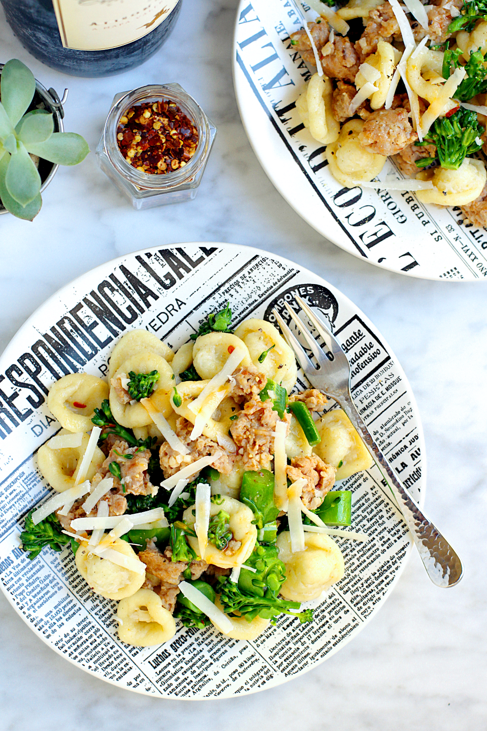 Image of homemade orecchiette with sausage and broccolini from the top.