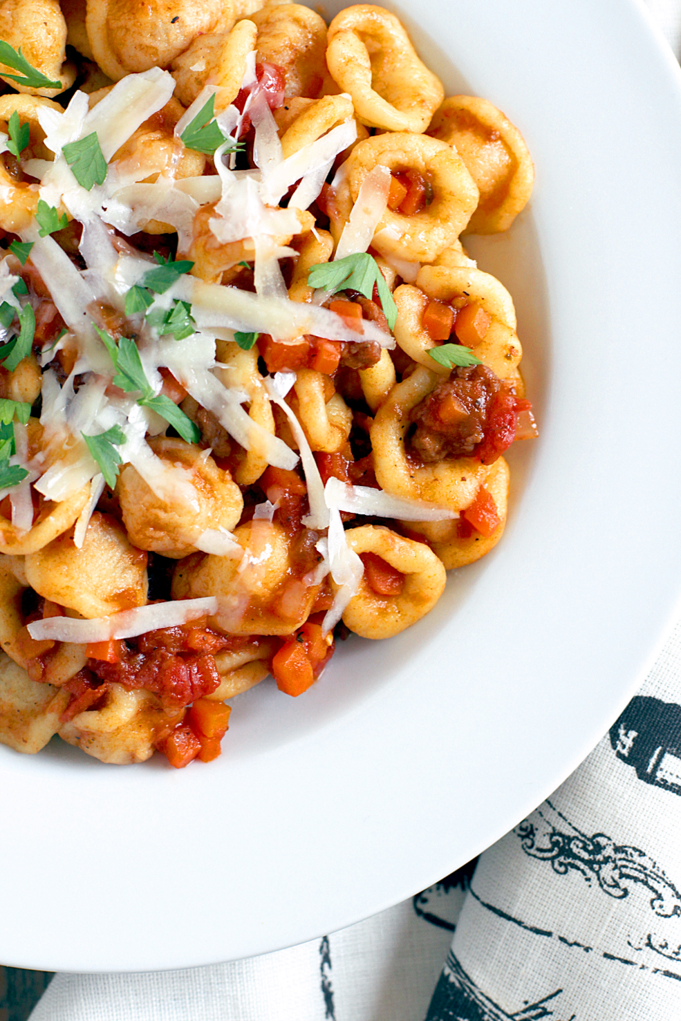 Close-up image of homemade orecchiette with spicy sausage sauce.