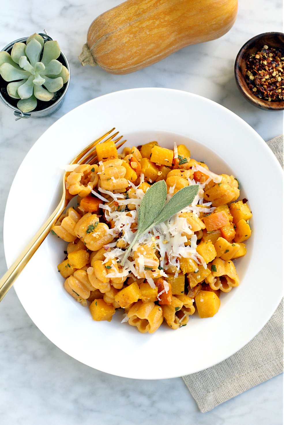 Image of pasta with butternut squash and sage.