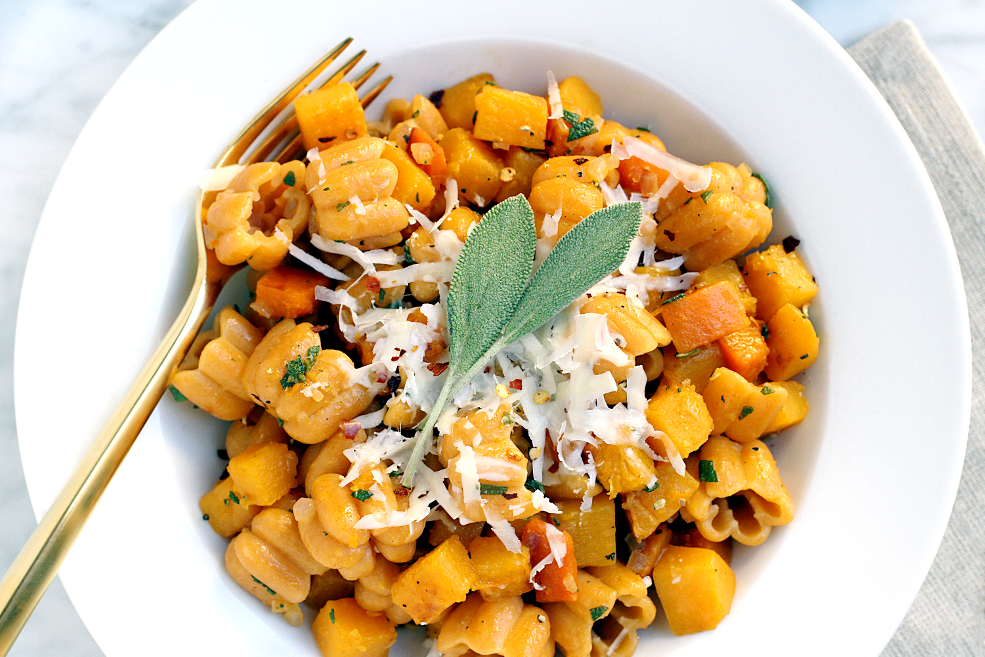 Close-up image of pasta with butternut squash and sage.