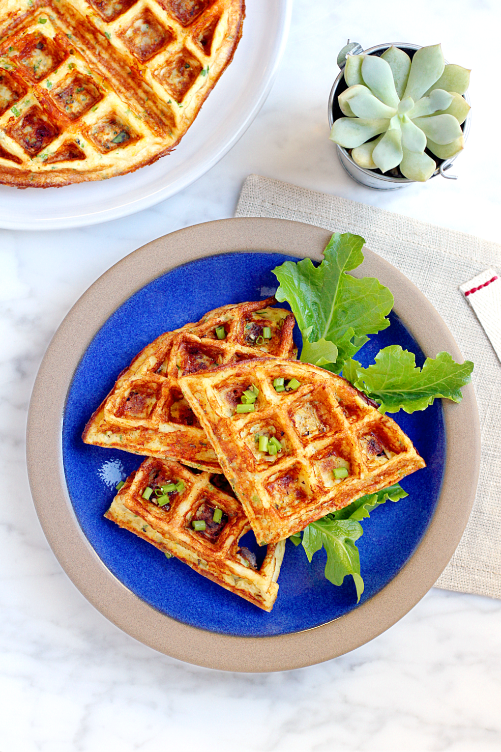 Image of cheesy cauliflower waffles from the top.