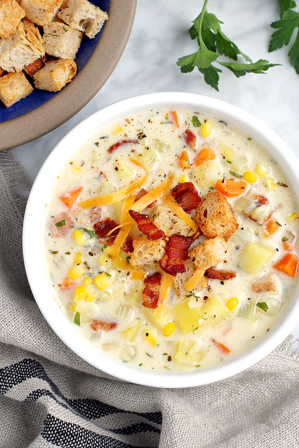 Close-up image of bacon, cheese and corn chowder.