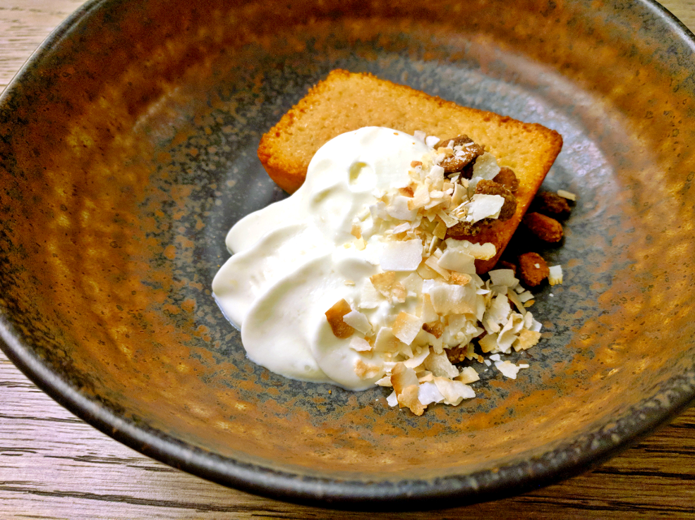 Image of almond brown butter cake with fried pistachios and whipped coconut cream prepared by Mark Nargi.