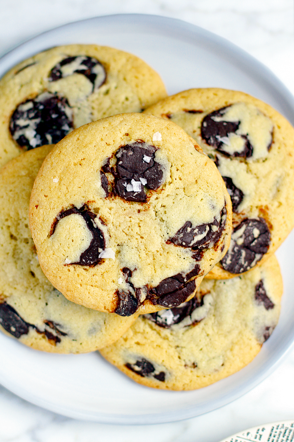 Close-up image of soft and chewy salted tahini chocolate chip cookies.